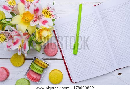 Spring Composition: Bright Flowers, Motley Almond Cookies And A Notebook For Your Text On A Wooden T