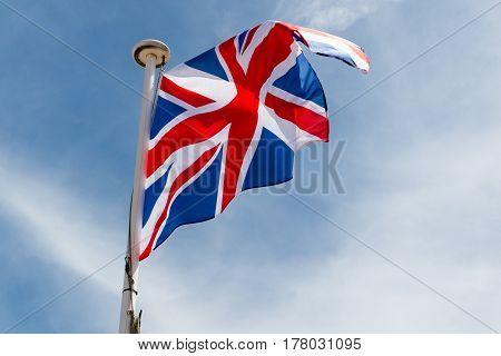 English United Kingdom Flag Floats On Top Of Mast