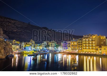 Xlendi Gozo - Beautiful aerial view over Xlendi Bay by night with restaurants and busy night life on the Island of Gozo