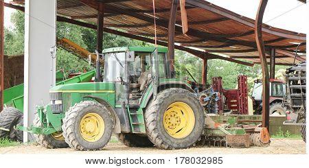 tractor near farm garage green vehicle for farmer worker