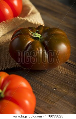 Raw Organic Red And Brown Heirloom Tomatoes