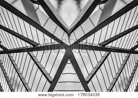 An iron roof of a tend taken from under it