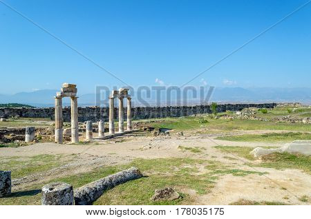 Ruins of the ancient city in Turkey on the background of blue sky