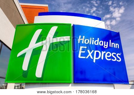 MINNEAPOLIS MN/USA - MARCH 19 2017: Holiday Inn Express Sign motel exterior. Holiday Inn Express is a mid-priced hotel chain branded by InterContinental Hotels Group.