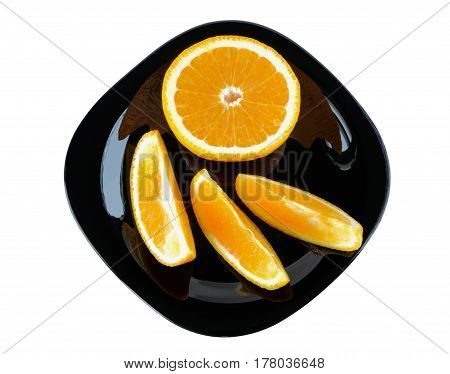 Slices of orange on a plate on white background