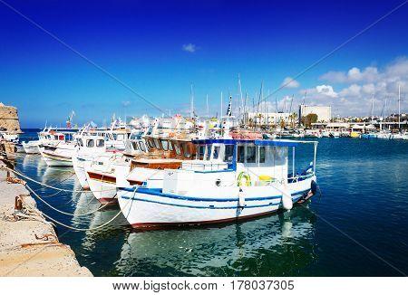 colorful fishing boats near old fortress, Heraklion port, Crete, Greece, retro toned