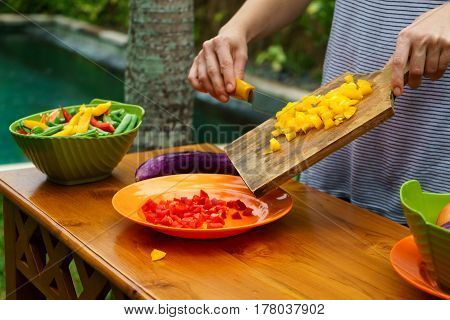 Culinary Workshop. Vegetable Salad With Own Hands In The Courtyard Of A Private House.