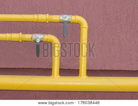 the large industrial pipes on red background