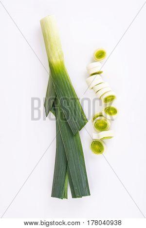 Onions leeks on white background. Studio Photo