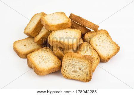 Crispy wheat crunches on white. Studio Photo
