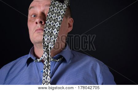 Nice portrait of mature office clerk who hates neck tie style