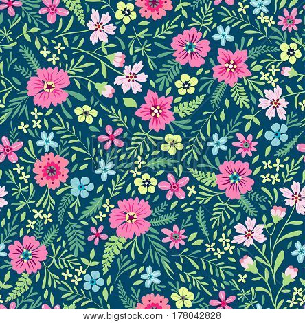 Seamless cute floral pattern. Small pink and blue flowers. Flower pattern on dark green background. Ditsy floral background. The elegant the template for fashion prints. Herbs and wild flowers.