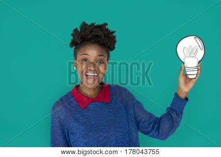 African Descent Woman Holding Light Bulb