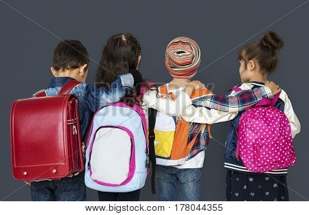 Rear view group of diverse kids wearing backpack