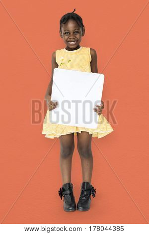 African little girl holding blank placard studio portrait