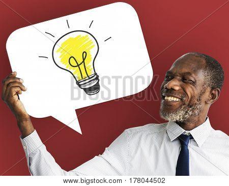 Businessman with lightbulb icon symbol