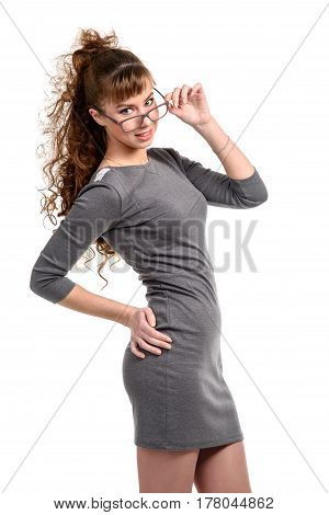 Woman looking at camera and touching her glasses isolated on white.