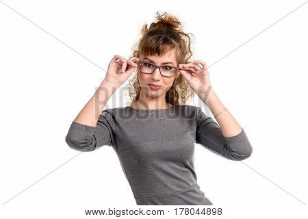 Young woman adjusting the glasses looking at camera isolated on white.
