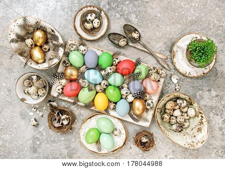 Easter eggs. Table decoration with quail eggs. Flat lay. Top view