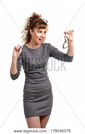 Excited cheerful woman posing with the sunglasses isolated on white.