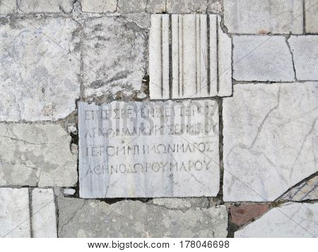 Ancient Hellenistic inscription on the plate on the road in antique city of Side, Turkey