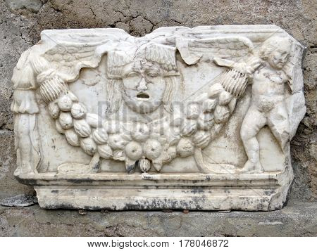 Part of the ancient columns and friezes on the ruins of the ancient city of Side