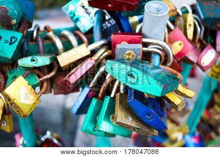 Colorful Padlocks On A Bridge. Love Forever. Lovers Leave It On The Bridge. As Long As The Padlocks