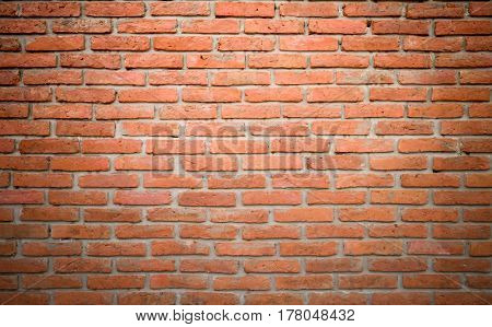 Weathered texture of stained old dark brown and red brick wall background grungy rusty blocks of stone-work technology colorful horizontal architecture Weathered texture of stained old dark brown and red brick wall background grungy rusty blocks of stone-