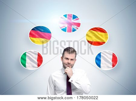 Pensive Businessman And Country Flags