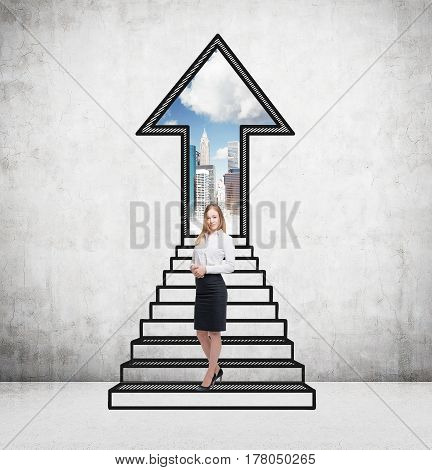 Portrait of a blond businesswoman standing near an arrow opening in a concrete wall with stairs leading to it.