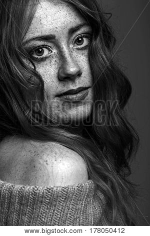 Black and white portrait of a beautiful freckled woman