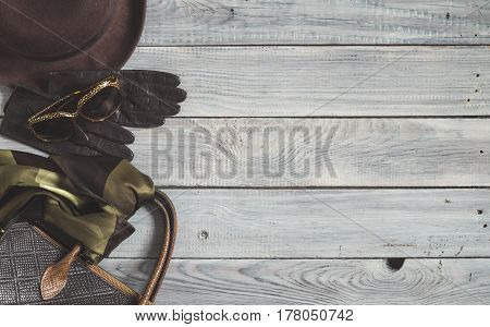 Female hat and retro accessories for travel on a white painted wooden surface