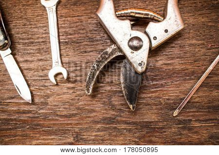 Old vintage retro grungy Work tools on dark old brown ancient wooden background