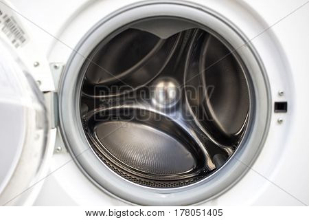 Inside View Of Opened Washing Machine. Silver Clean