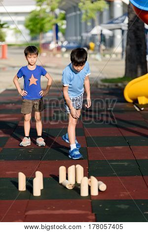 Young Asian Boy Play With Wooden Toy Number