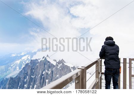 Asian Tourist Look At Mont Blanc Massif.