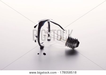 Dirty Tungsten Light Bulb On A White Background.