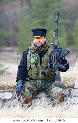 ESTONIA, APRIL 9, 2016: Unidentified people take part in the East-West Airsoft Game East at the Humala abandoned rocket base.