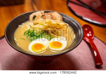 Japanese ramen soup with eggs in the bowl