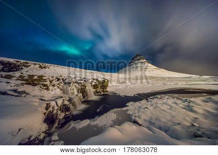 Kirkjufell snowy mountain before winter blizzard Iceland