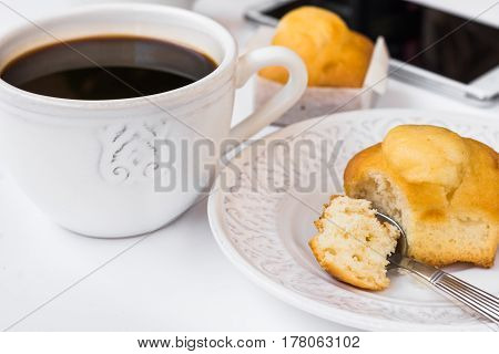 White desktop with cup of coffee plate with muffin and smartphone styled image for social media female blogging business website header