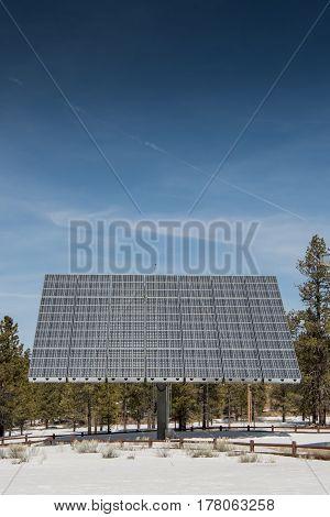 Large Solar Panel Below Blue Sky in winter