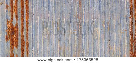 A banner background made of rusty zinc wall.
