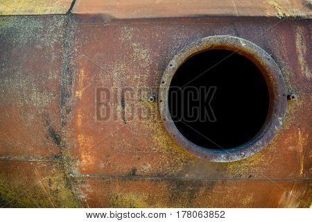 Opened Rusty Manhole On Orange Fuel Tank