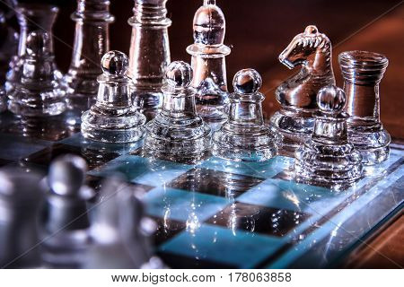 transparent glass chess board and figures with reflections