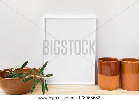 Frame mockup earthenware glazed crockery olive tree branch on white background styled image for social media product marketing branding