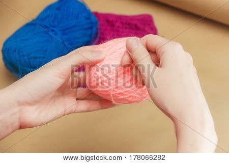 Close up of the hands of an young woman knitting