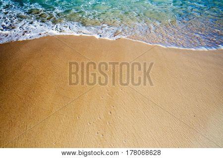 A crystal clear creamy wave on the beach. New Providence, Nassau, Bahamas.