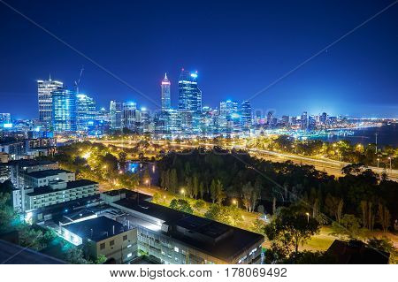 Skyline city of Perth from Kings Park with a view of John Oldany Park at night. Australia .