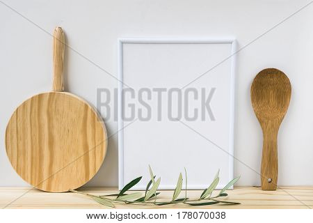Frame mockup wood cutting board spoon olive tree branch on white background styled image product marketing banner online store